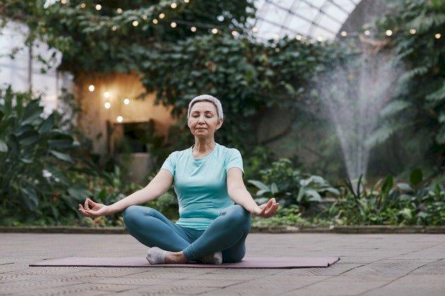 An older woman doing yoga.